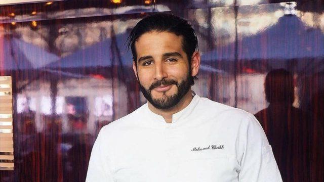 Mohamed Cheikh souriant en tenue de chef cuisinier